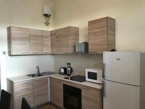 A kitchen or kitchenette at Seafront Apartment in the Heart of Kalkara