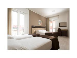 Letto o letti in una camera di Hotel Gardenia