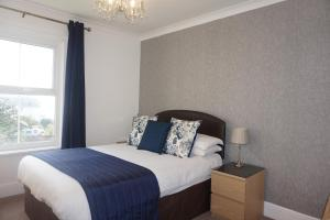 A bed or beds in a room at The Havelock