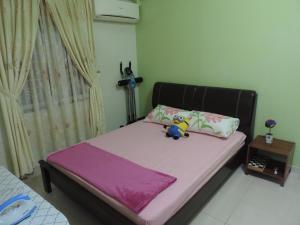 """A bed or beds in a room at Travel Story(""""吕""""游故事)"""