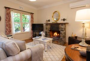 A seating area at Merrow Cottages - Gatehouse