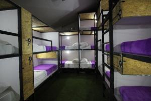 Litera o literas de una habitación en Hostel la Antigua Capsula