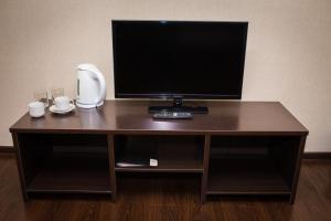 Телевизор и/или развлекательный центр в Гостиница Акият