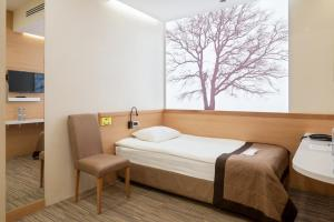 A bed or beds in a room at Airhotel Express