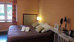 Een bed of bedden in een kamer bij Chez Francoise