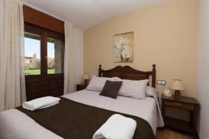 Cama o camas de una habitación en Hotel Rural Santa Inés