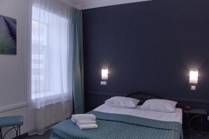 A bed or beds in a room at OK Hotel