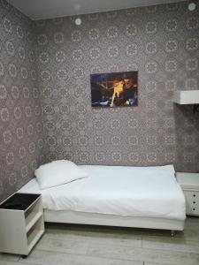 A bed or beds in a room at Airport City Lodge