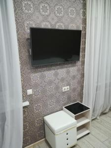 A television and/or entertainment center at Airport City Lodge