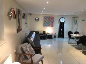 A seating area at 247 London Hostel