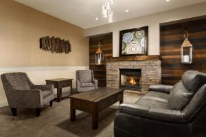A seating area at Days Inn & Suites by Wyndham Brooks