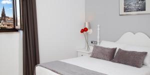 Кровать или кровати в номере Hotel Carlos V