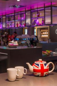 A restaurant or other place to eat at Moxy London Stratford