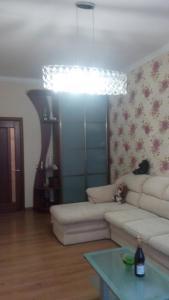 Гостиная зона в Apartment on Fortovaya Doroga
