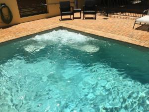 The swimming pool at or near Taihoa Holiday Units Adults Only