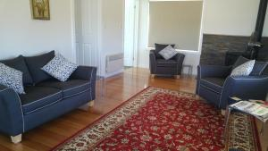 A seating area at Little Sunnyside Accommodation