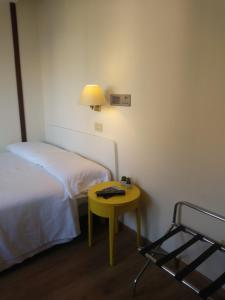 A bed or beds in a room at Hotel La Capannina