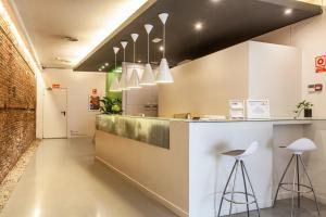 Una cocina o zona de cocina en Urban Sea Hotel Atocha 113
