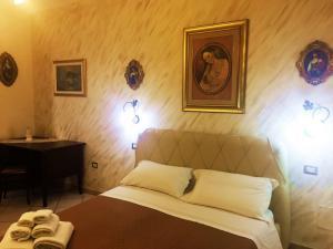 Letto o letti in una camera di B&B Casa Alba Salentina