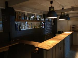 The lounge or bar area at Le Penguin Hostel