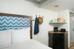 A bed or beds in a room at Bilmar Beach Resort