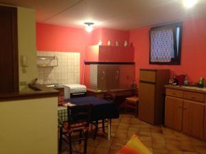 A kitchen or kitchenette at B&B Al Pozzo dei Sogni