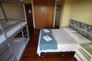 Cama ou camas em um quarto em Hostel Pico do Itambé