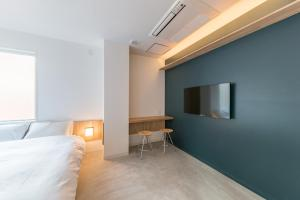 A television and/or entertainment center at &AND HOSTEL AKIHABARA