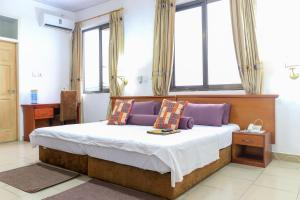 A bed or beds in a room at Asantewaa Premier Guesthouse