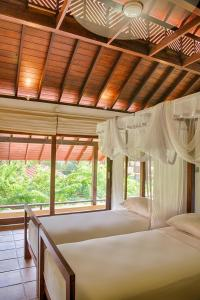A bed or beds in a room at Jetwing Ayurveda Pavilions (Full Board + Treatments) - Level 1 Safe & Secure