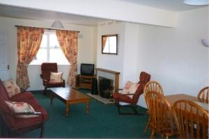 A seating area at Yew Wood Holiday Homes