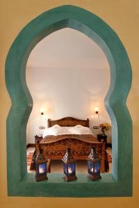 Cama o camas de una habitación en Alcoba del Rey de Sevilla