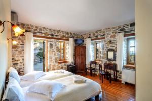 Ένα ή περισσότερα κρεβάτια σε δωμάτιο στο Eos - Authentic Experience