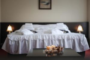A bed or beds in a room at Hotel Palma