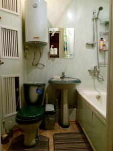 A bathroom at Apartment in Gribanowski