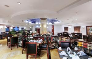 A restaurant or other place to eat at Grand Candi Hotel
