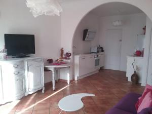 A television and/or entertainment center at Petite Fleur d'Azur
