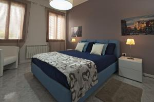 A bed or beds in a room at Al Miraggio