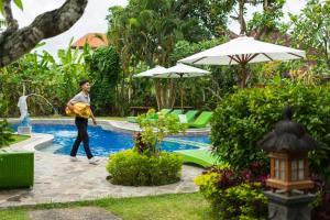 The swimming pool at or near Bali Wirasana Inn