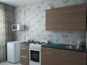 """A kitchen or kitchenette at Апартаменты""""Like Home"""" на Фрунзе 49"""
