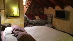 A bed or beds in a room at Posada d'Àneu