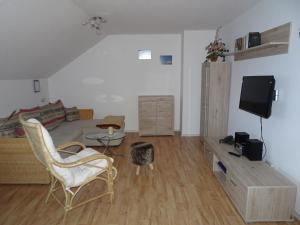 Ein Sitzbereich in der Unterkunft Gästehaus Eberle