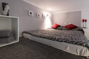 Łóżko lub łóżka w pokoju w obiekcie studio blizniacze