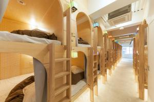 A bunk bed or bunk beds in a room at &AND HOSTEL AKIHABARA