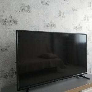 """A television and/or entertainment center at Апартаменты""""Like Home"""" на Фрунзе 49"""