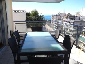 A balcony or terrace at Elvita Athens Sea View Maisonette