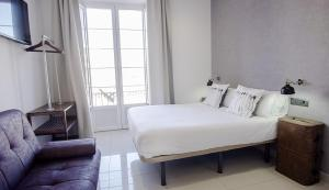 A bed or beds in a room at The Lights Suites
