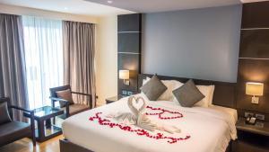 Кровать или кровати в номере Unique Regency Pattaya