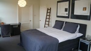 A bed or beds in a room at Room One-Twenty-One