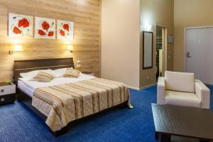 Кровать или кровати в номере Триумф Отель
